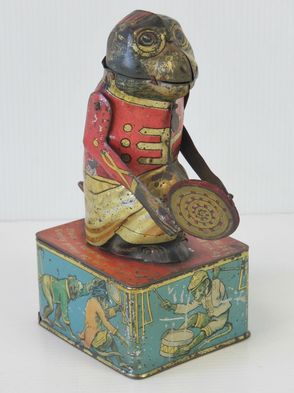A rare tin plate monkey money box with m