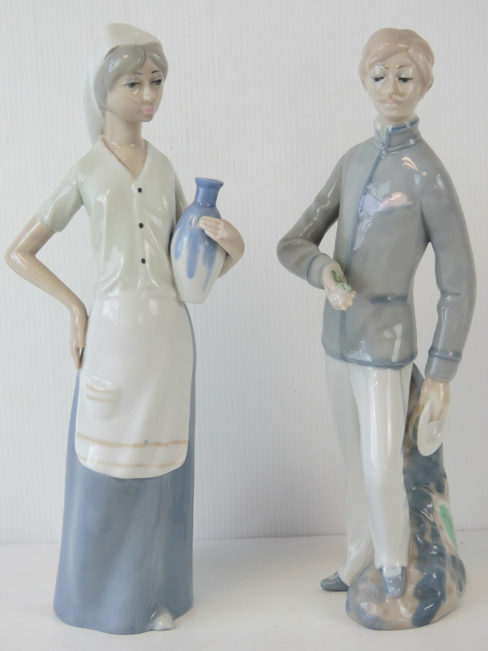 A pair of Spanish porcelain figures by C