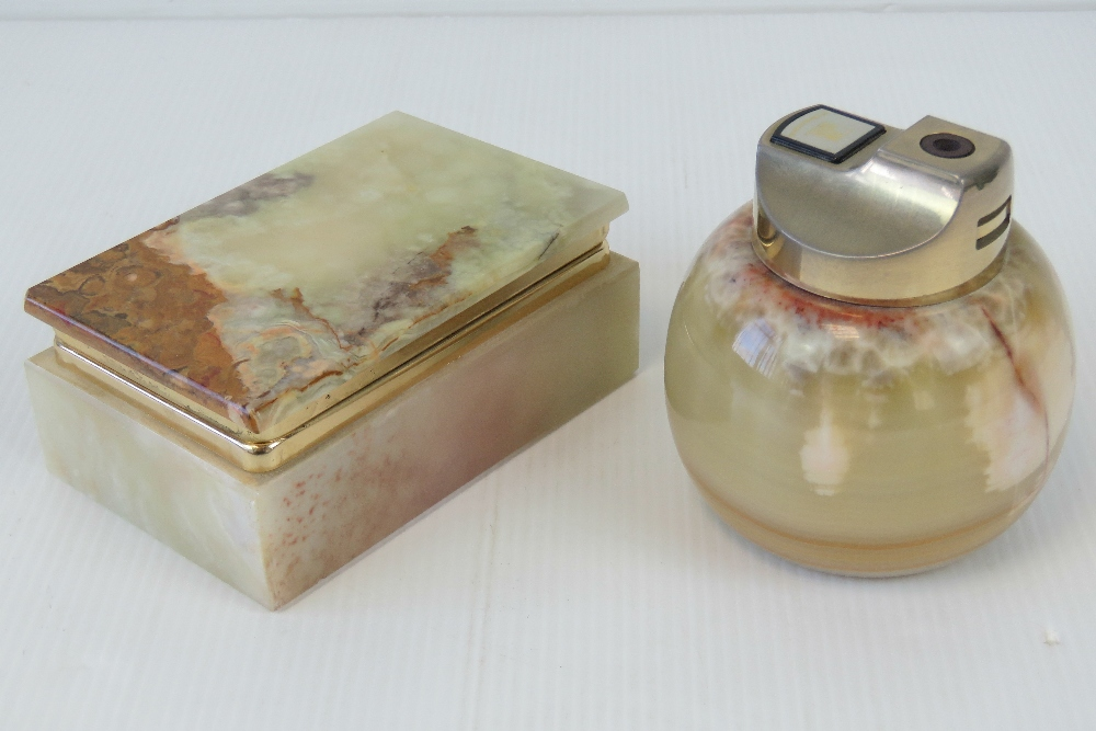 An alabaster table lighter by Win, toget