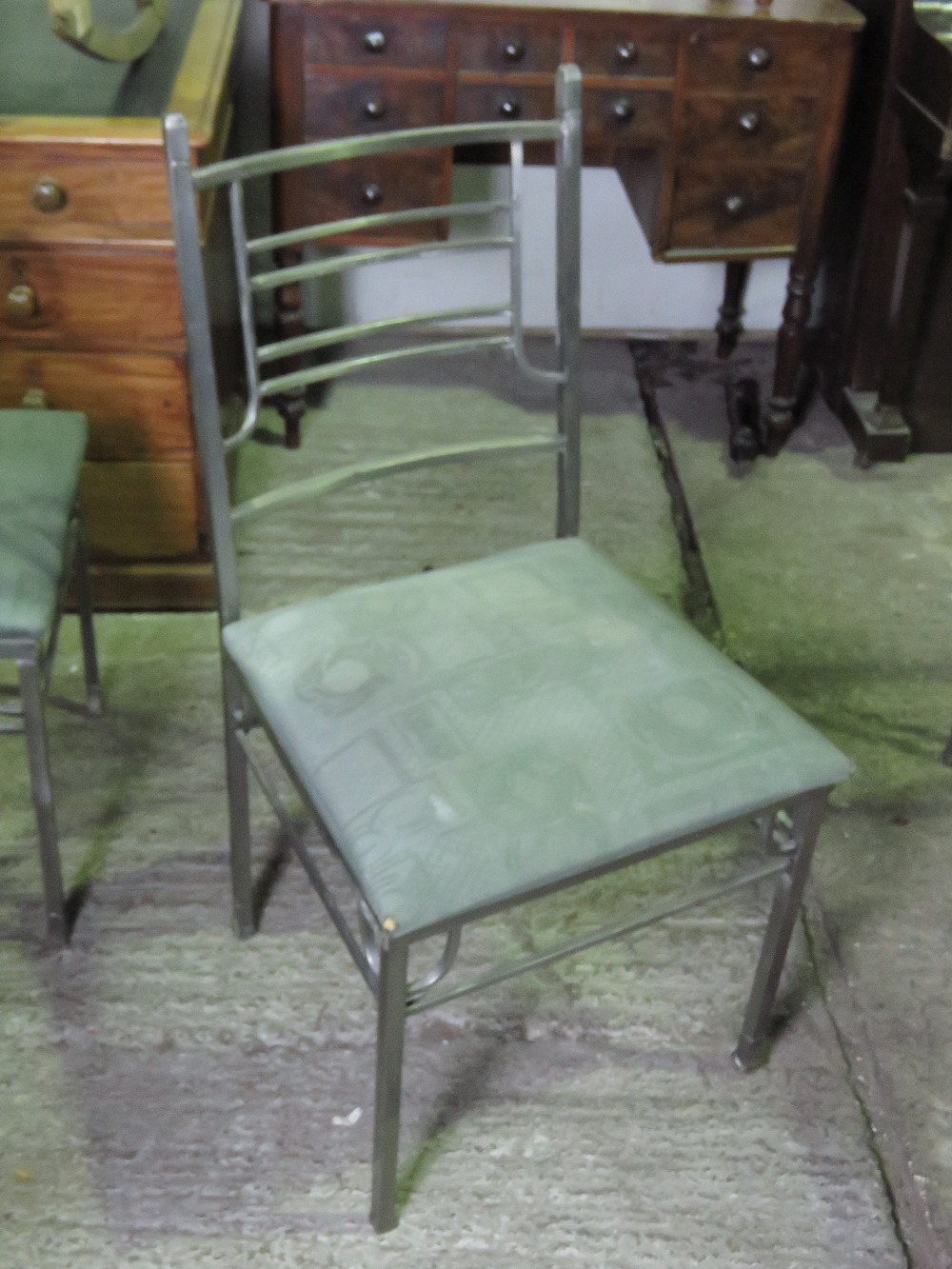 Lot 729 - A contemporary metal framed dining table