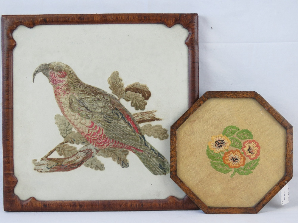 A Victorian needlework panel of a parrot