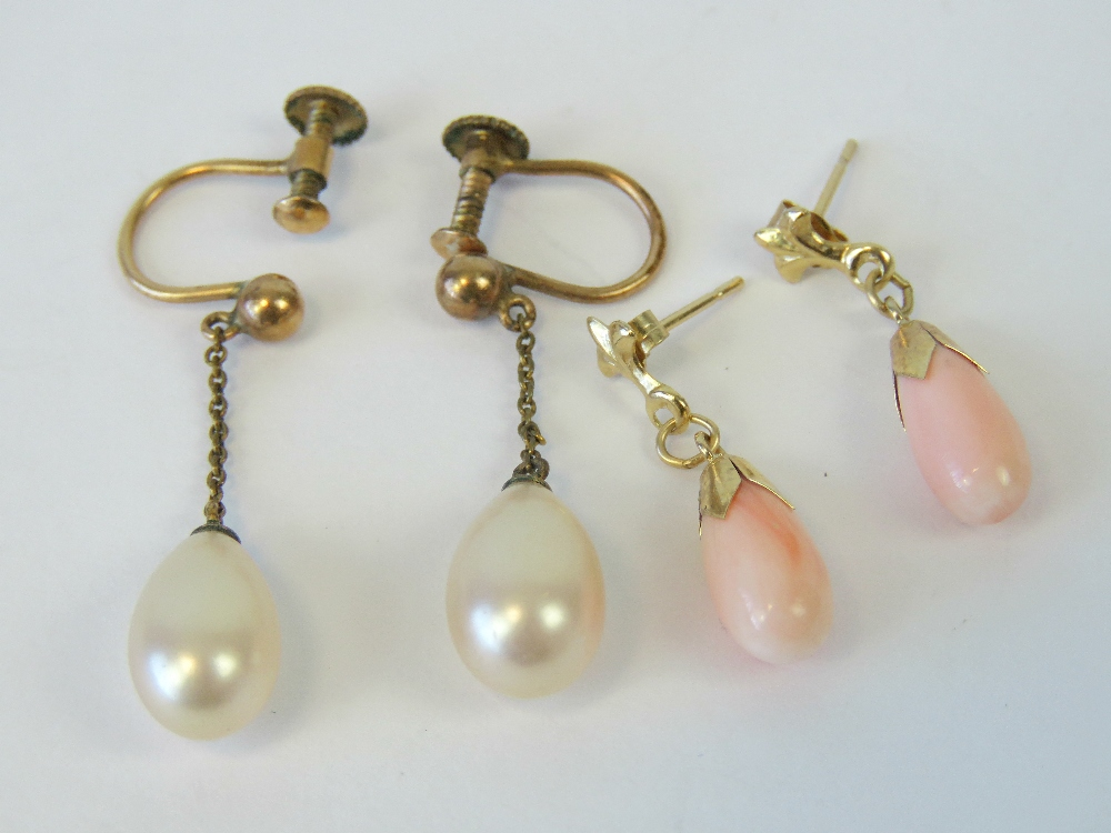 A pair of angel skin coral earrings havi