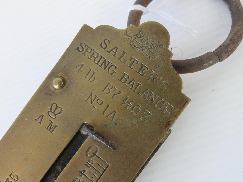 Lot 515 - A set of Salter's brass spring balances