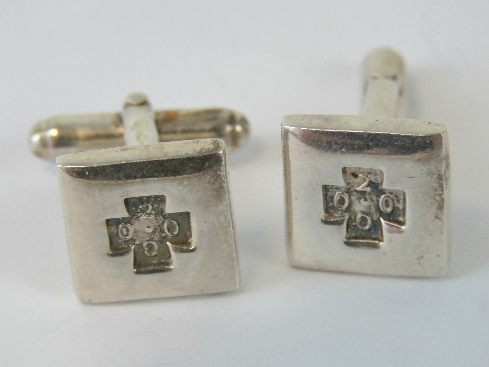 A pair of square shaped HM silver cuffli