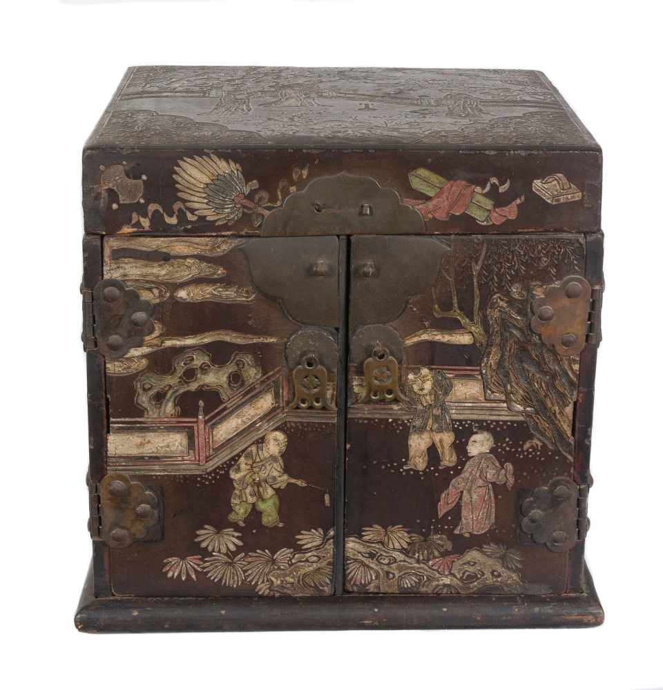 """A """"Bantamwork"""" or coromandel lacquer and brass table cabinet. China. Qing dynasty. 18th century."""