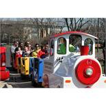 Royal Rides Trackless Train and custom 24' long V-Nose trailer with 3 access doors and fold down ram