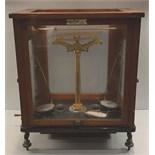 Antique L Oertling Scientific Scales in Glass Oak Framed Case.