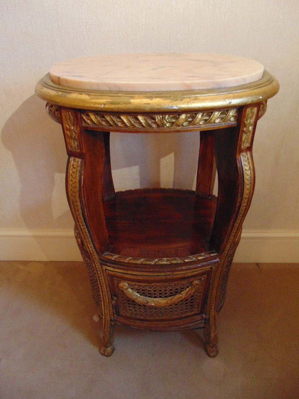 Lot 12 - An oval side table with marble inset top and bergere panels to the sides, A/F