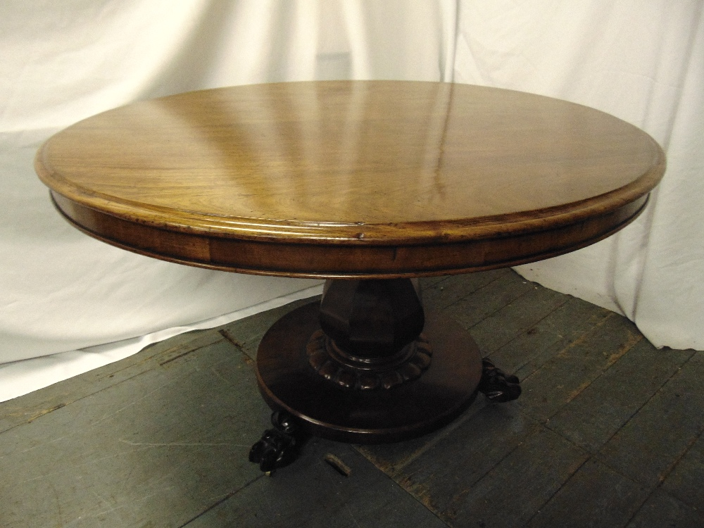Lot 9 - A Victorian mahogany circular tilt top dining table on circular base with claw feet