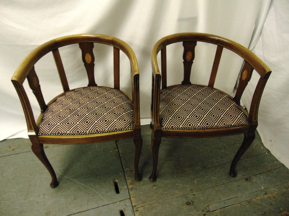Lot 27 - A pair of Edwardian mahogany inlaid slatted back occasional chairs on cabriole legs