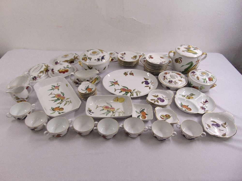 Lot 103 - Royal Worcester Evesham pattern part dinner service, cups, saucers, serving dishes and covered