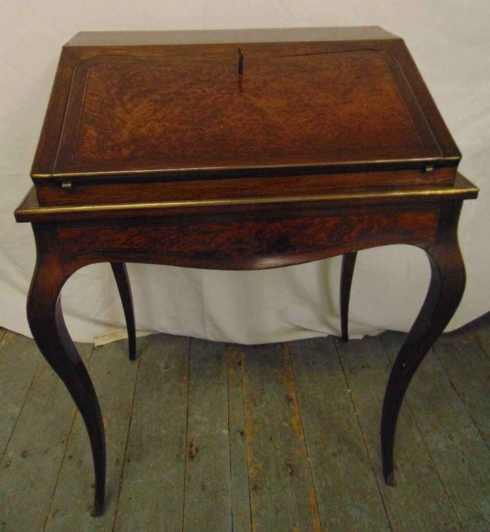 Lot 1 - A 19th century rectangular walnut and mahogany desk with brass mounts on four cabriole legs