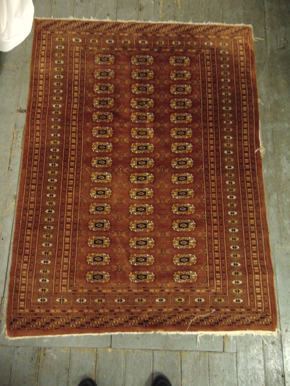 Lot 34 - Persian wool carpet red ground with geometric repeating pattern and border, 178 x 133cm