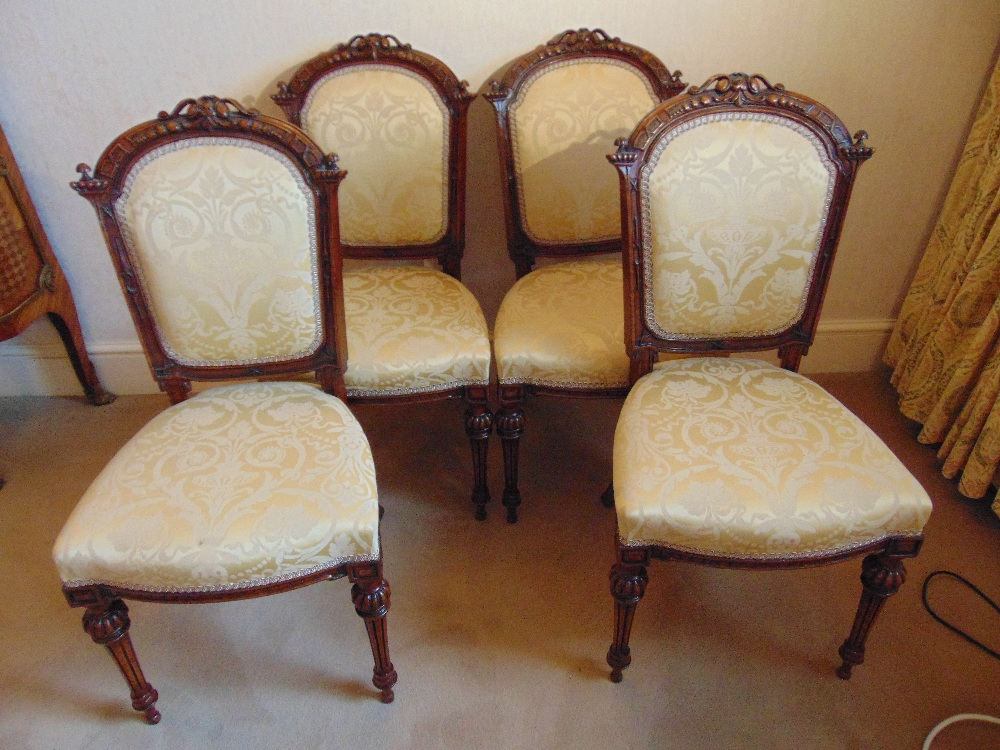 Lot 25 - Four Victorian upholstered dining chairs on tapering fluted baluster legs