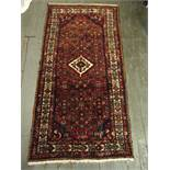 Persian wool runner red ground with green and blue repeating pattern and cream border, 200 x 104cm