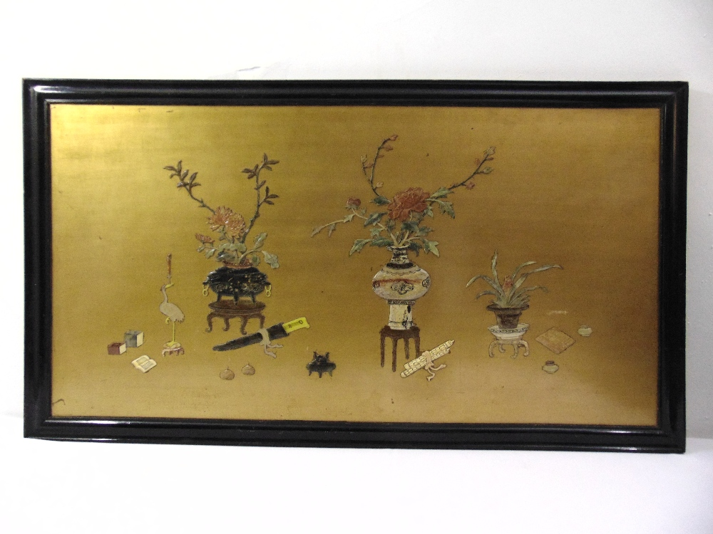 An oriental rectangular lacquered wall panel set with vases and naturalistic forms of semi
