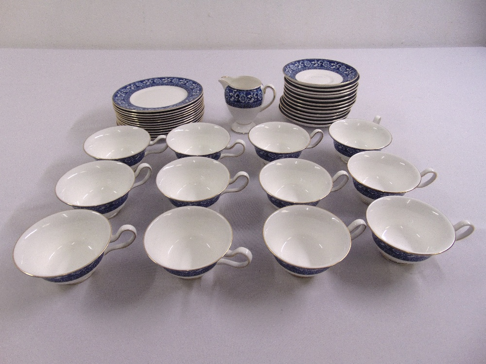 Wedgwood part tea set in blue and white to include cups, saucers, a sandwich plate and a cream