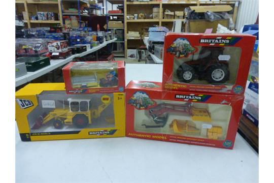 Three Britains 1:32 die cast farm yard vehicles comprising