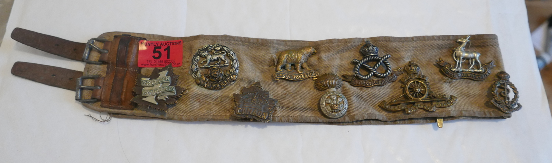 "Lot 51 - Antique Belt 28"" long holding some 13 Miltary Badges."