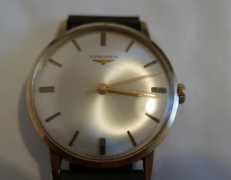 Lot 47 - Vintage 9 karat Gold Gents Longines Watch in an working order.