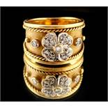 Property of a lady - an 18ct gold ring of tapering band form, set with a diamond flowerhead with a