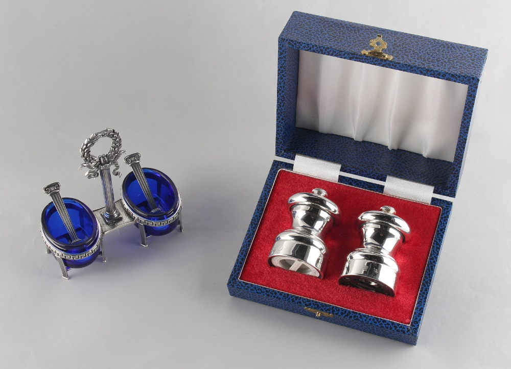 Lot 223 - Property of a gentleman - a Giovanni Raspini silver double salt stand, with blue glass liners &
