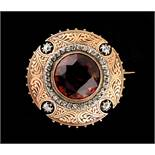 A Madeira citrine & diamond circular brooch, the round cut citrine measuring approximately 17mm