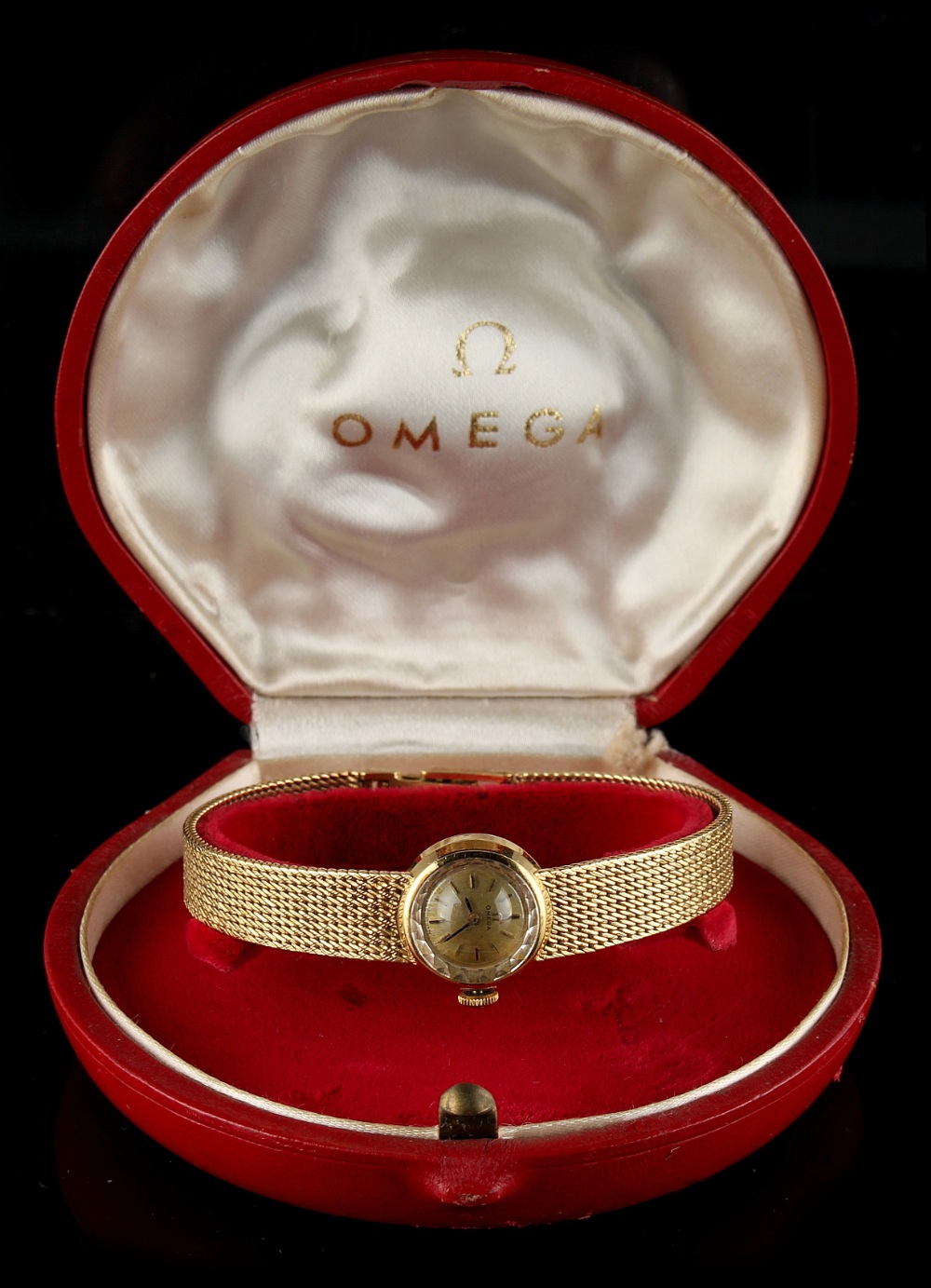 Property of a deceased estate - a lady's Omega 18ct yellow gold cased wristwatch with integral