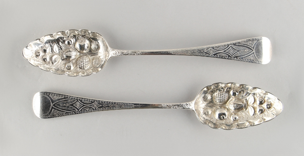 Lot 236 - Property of a deceased estate - a pair of George III later repousse berry decorated table spoons,