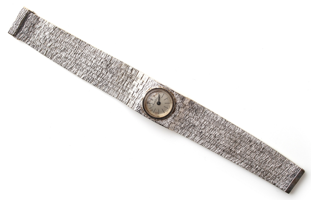 Property of a lady - a lady's Bueche-Girod 9ct white gold wristwatch with integral 9ct white gold