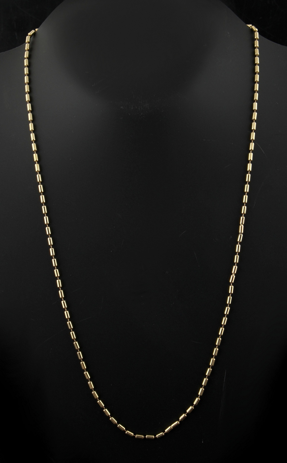 Property of a lady - a 9ct gold chain necklace of tubular form, 24.5ins. (62cms.) long.