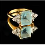 Property of a lady - an 18ct yellow gold aquamarine & diamond ring, the rectangular cut aquamarine