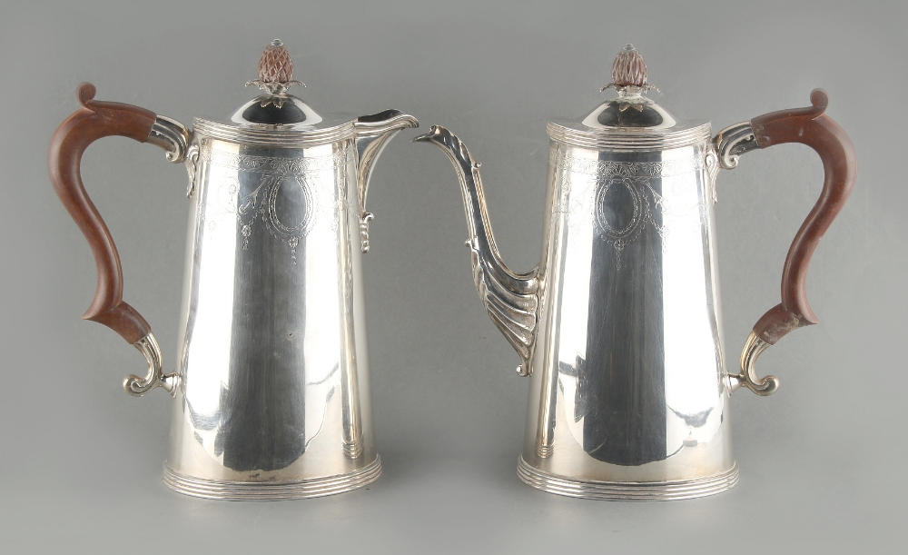 Lot 208 - Property of a lady - a silver coffee pot and matching hot water jug, each of tapering oval form with