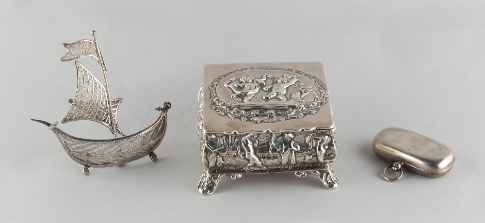Lot 229 - Property of a lady - a late Victorian silver square box with repousse decoration depicting putti,