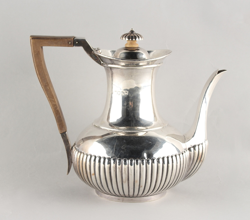 Lot 248 - Property of a deceased estate - a Victorian silver coffee pot with half fluted decoration, makers