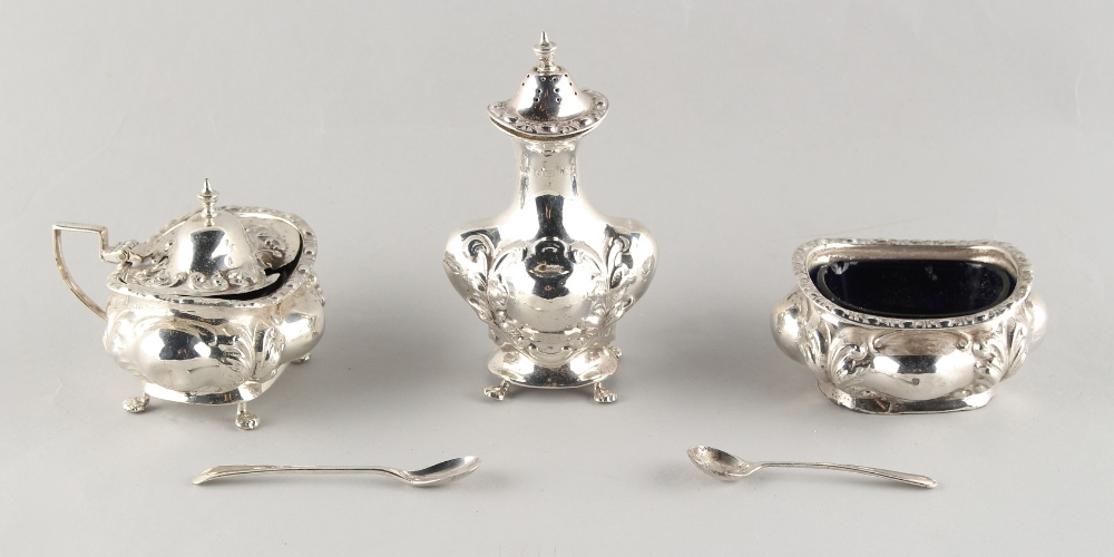 Lot 244 - Property of a deceased estate - an early 20th century silver three-piece condiment set, makers Jones