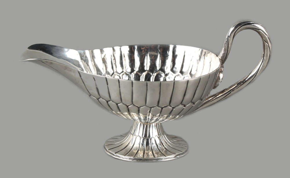 Lot 214 - Property of a lady - a Sanborns Sterling silver sauceboat, of fluted pedestal form, the ropetwist