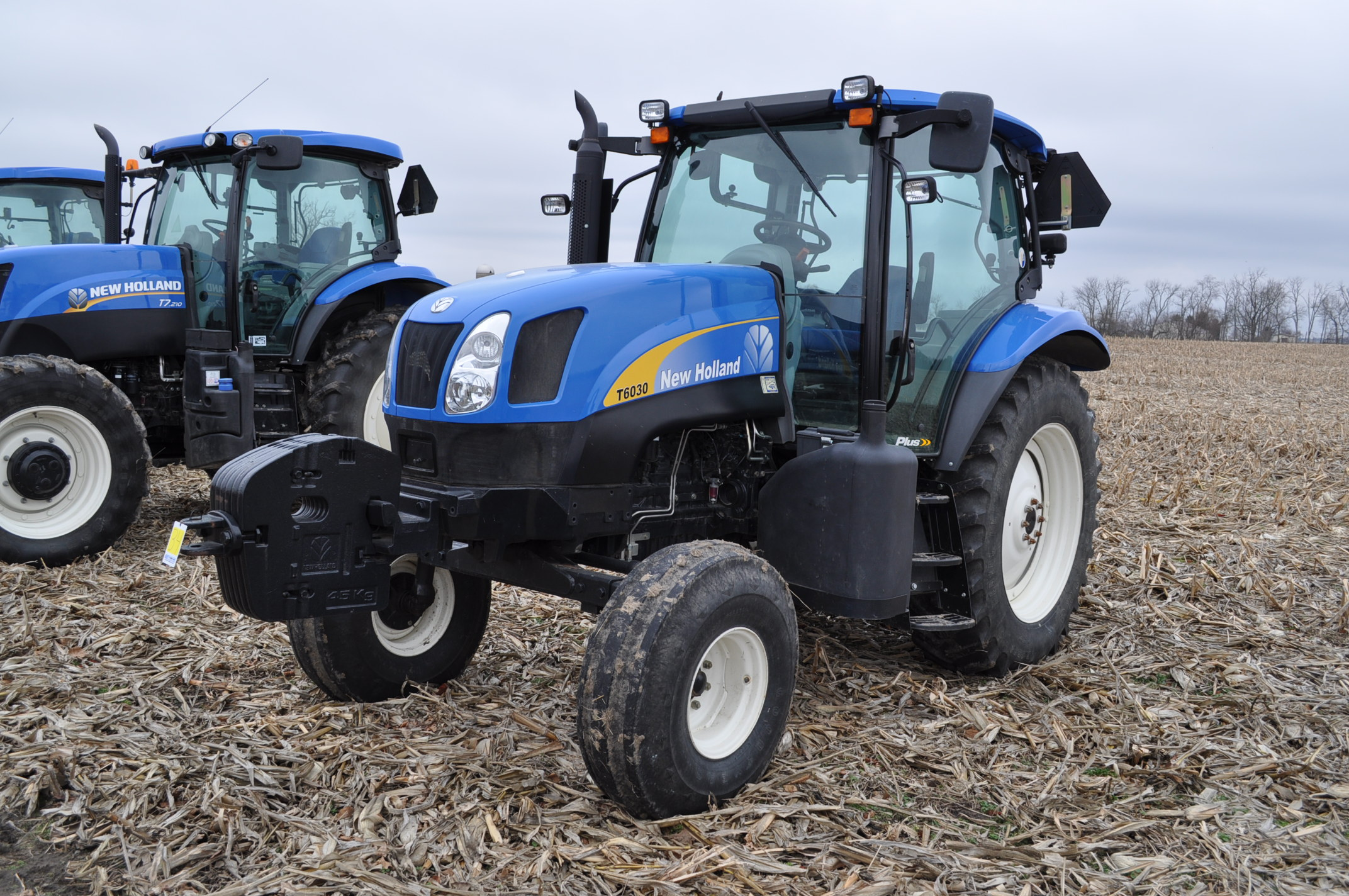 New Holland T6030 tractor, CHA, 16.9 R 38 tires, 11.00-16 front, 6 front wts, 3 hyd remotes, 3 pt,
