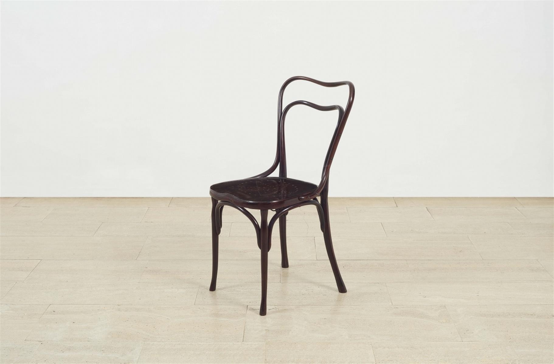 """Lot 60 - Stuhl """"Café Museum""""Buche als Bugholz, dunkelrot gefasst, perforiert, Schmiedeeisen. Fassung der"""