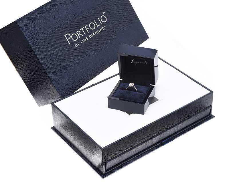 Lot 44 - PLATINUM DIAMOND HALO CLUSTER RING
