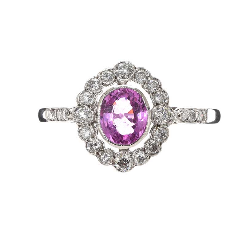 Lot 56 - 18CT WHITE GOLD PINK SAPPHIRE AND DIAMOND RING