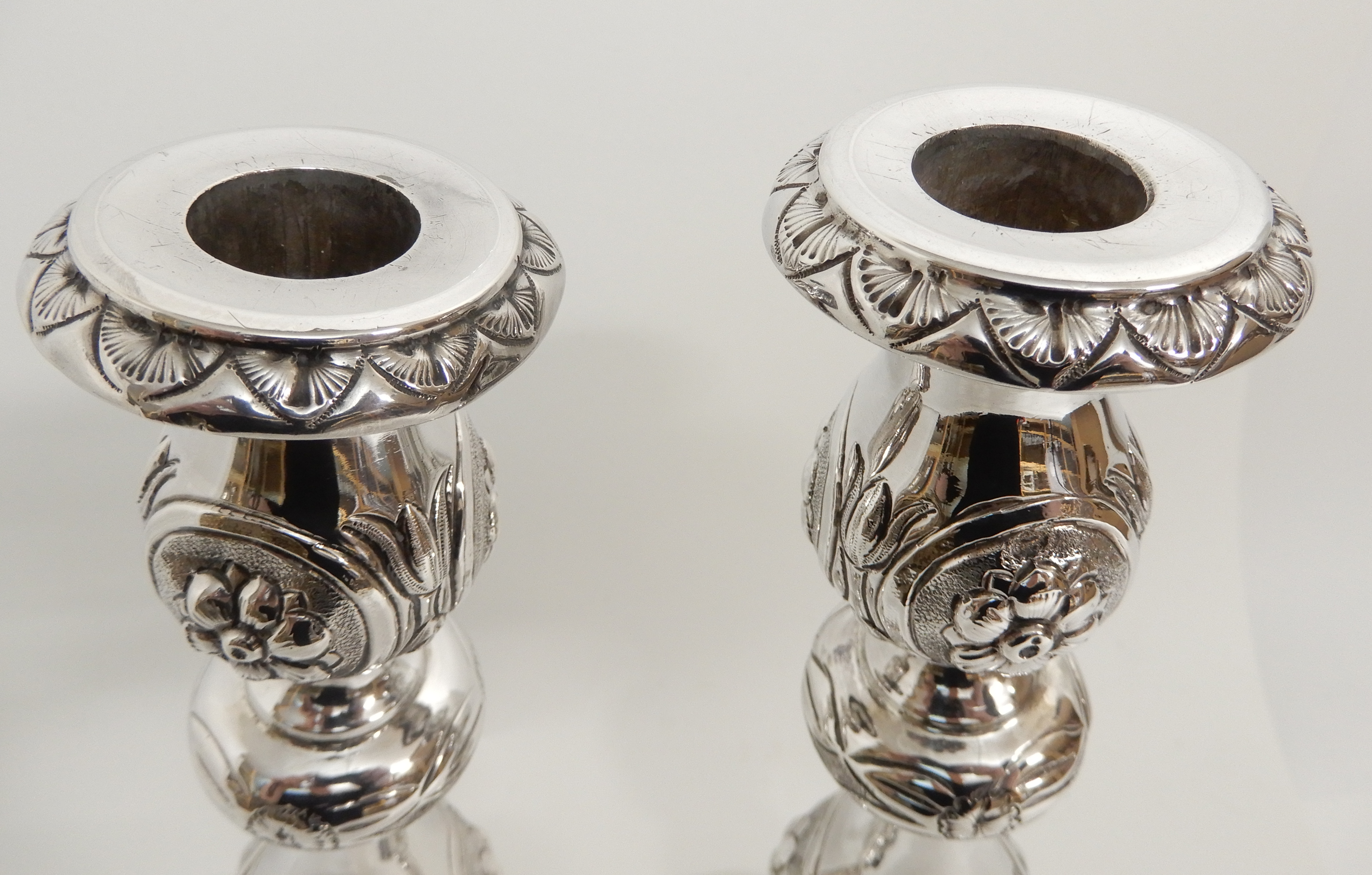 Lot 146 - A PAIR OF VICTORIAN SILVER CANDLESTICKS by Slade & Kempton, London 1902, with removable drip pans,