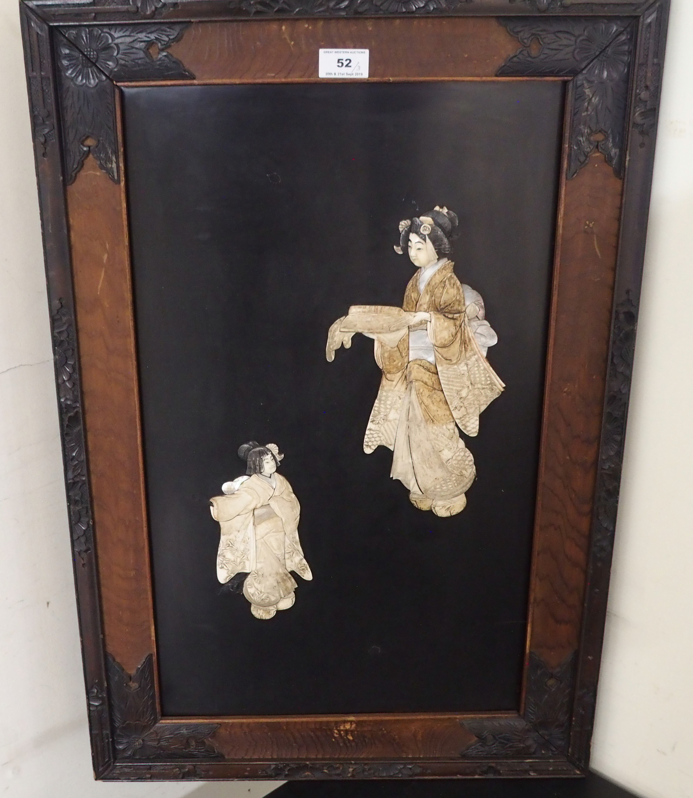 Lot 52 - THREE JAPANESE ONLAID WALL PLAQUES each decorated with a mother and child holding a scroll and