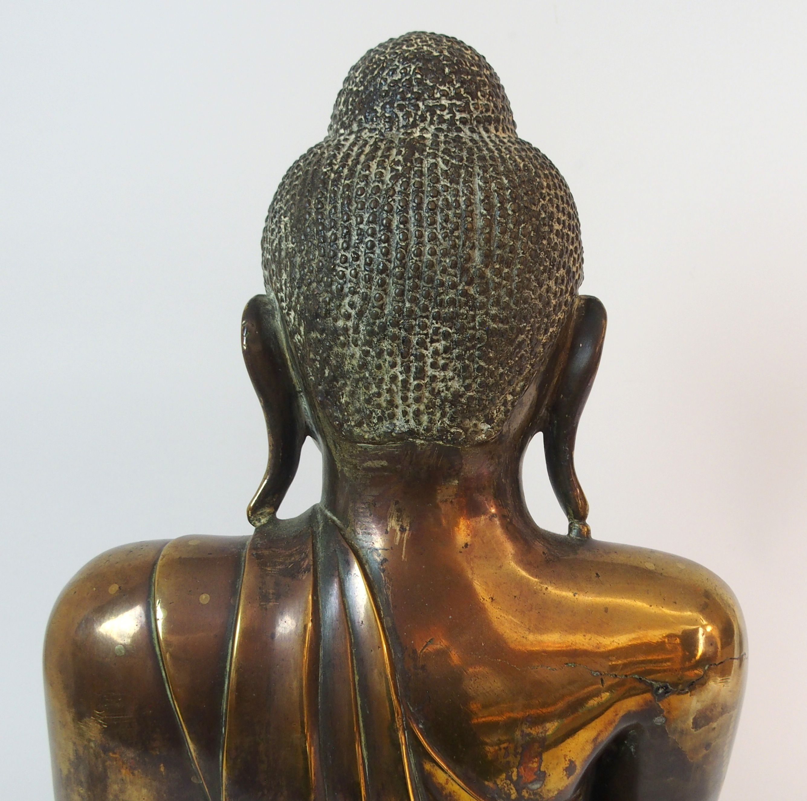Lot 68 - AN INDIAN BRASS MODEL OF BUDDHA seated in lotus position and hand touching earth to witness, 55cm