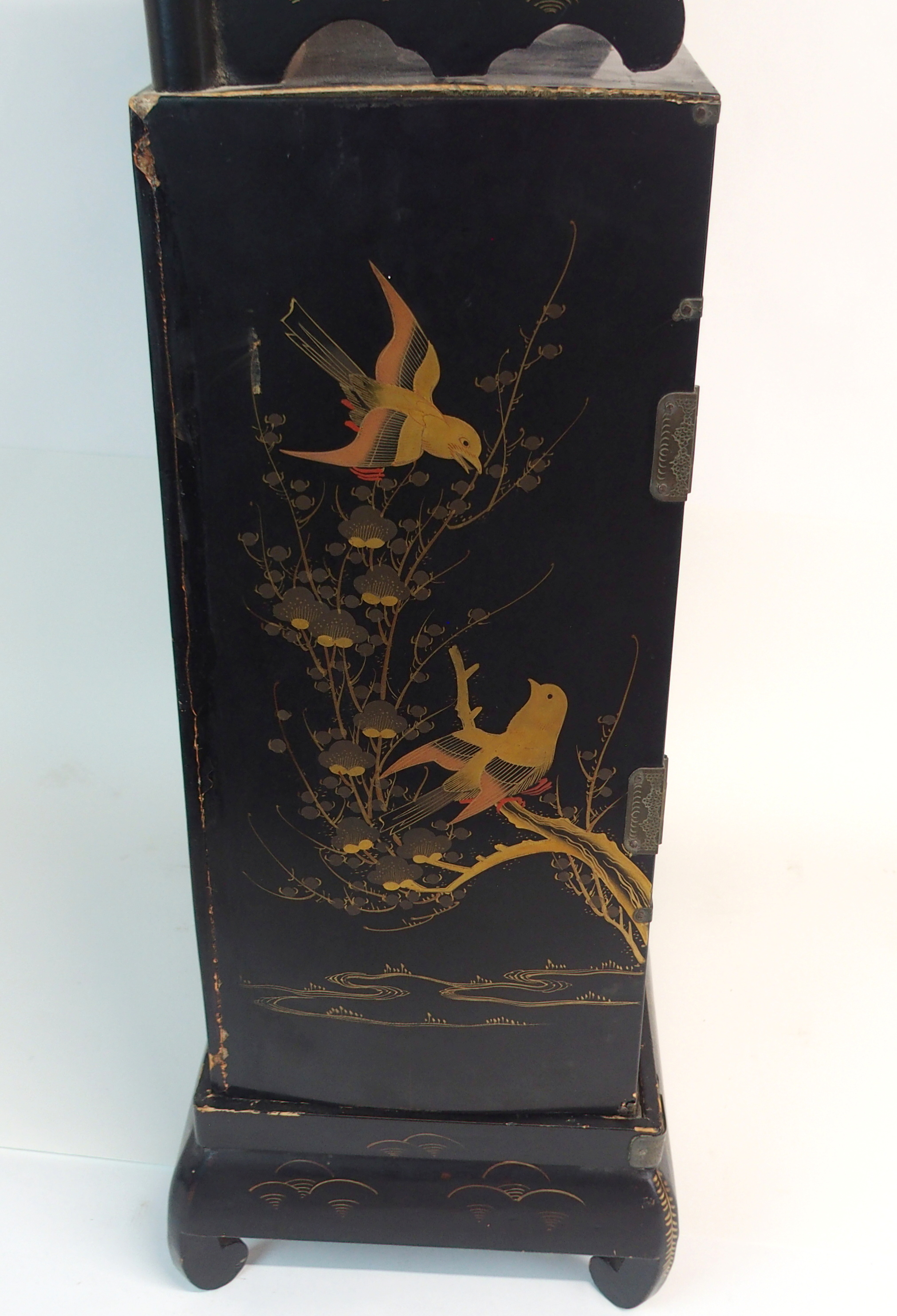 Lot 30 - A JAPANESE BLACK AND GOLD LACQUERED CABINET decorated with views of Mount Fuji, fitted with a pair