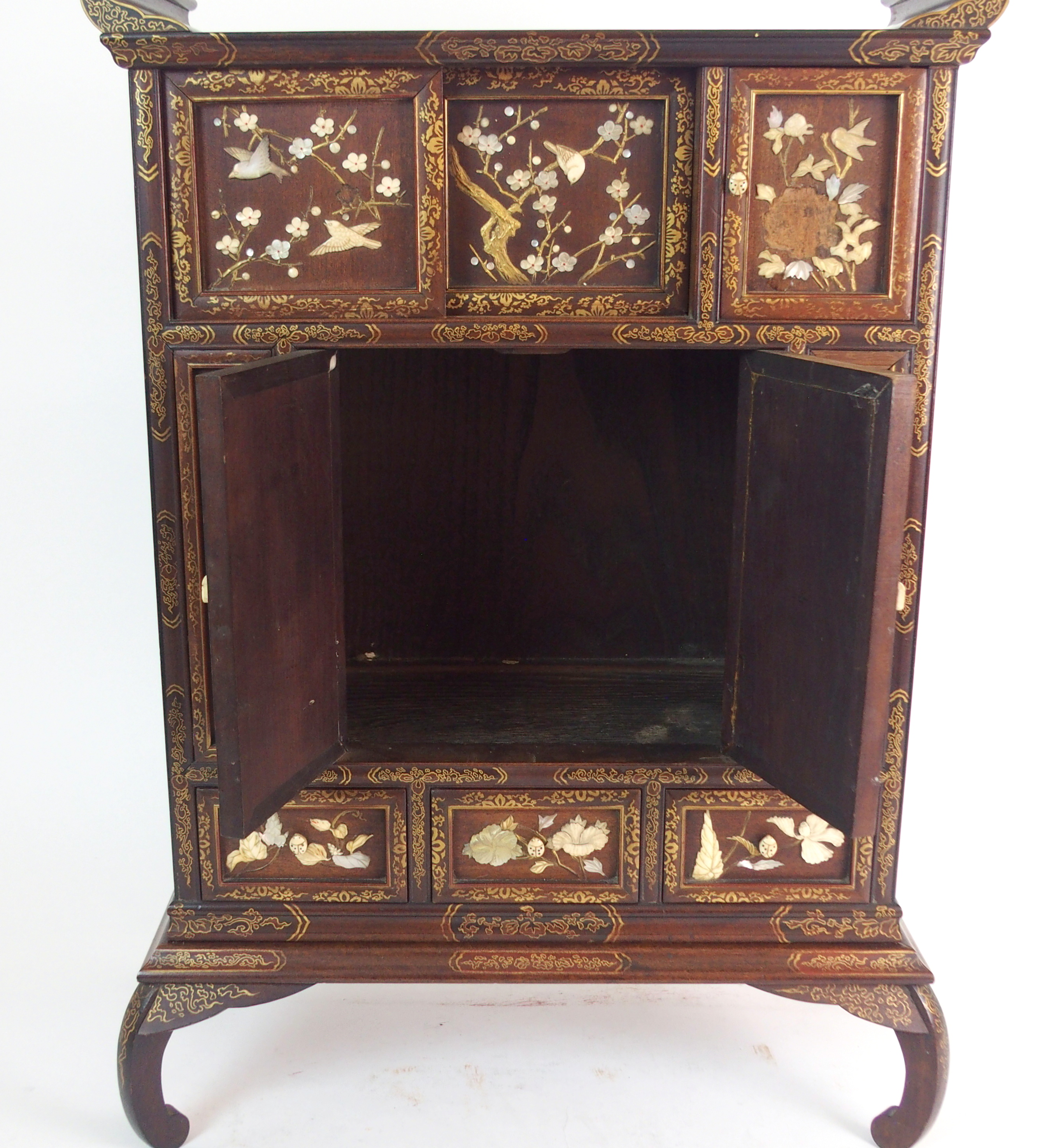 Lot 63 - A JAPANESE SHODANA CABINET with a pair of sliding doors and a hinged door above a pair of doors
