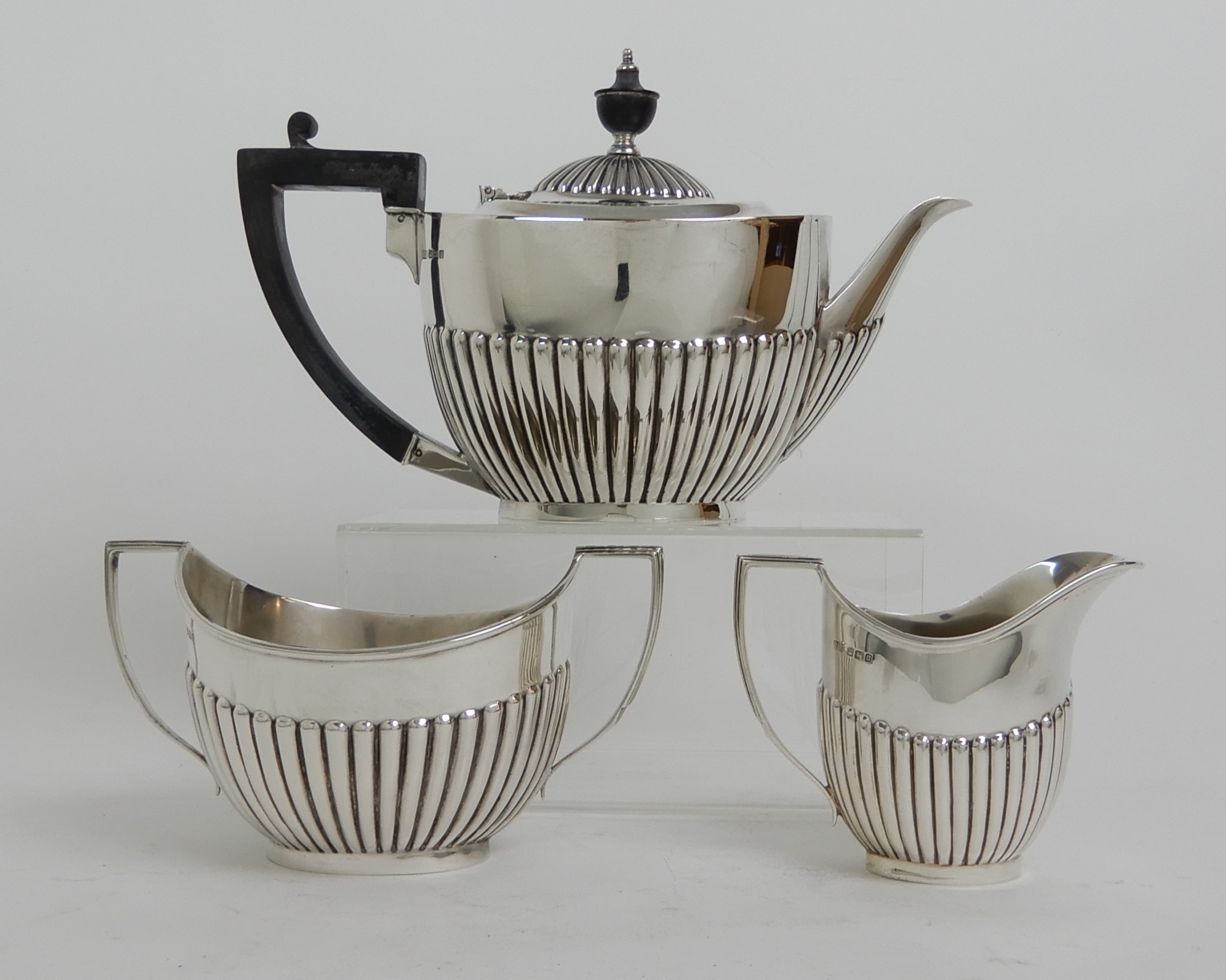 Lot 156 - A THREE PIECE SILVER TEA SERVICE by Roberts & Belk, Sheffield 1912, of oval form with half ribbed