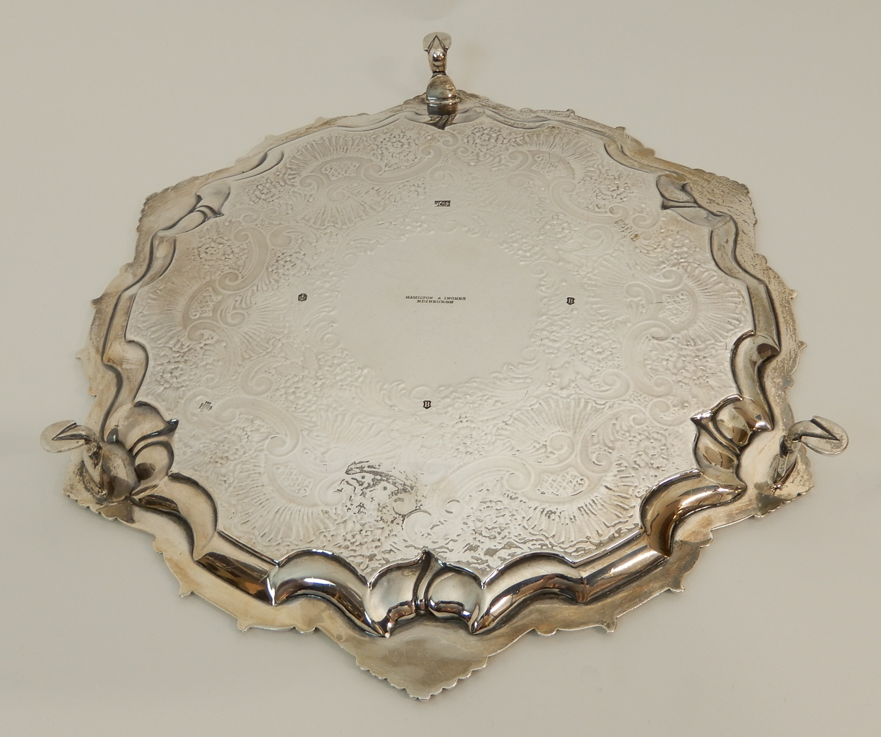 Lot 148 - AN EDWARDIAN SILVER SALVER by Hamilton & Inches, Edinburgh 1907, of circular form with scalloped