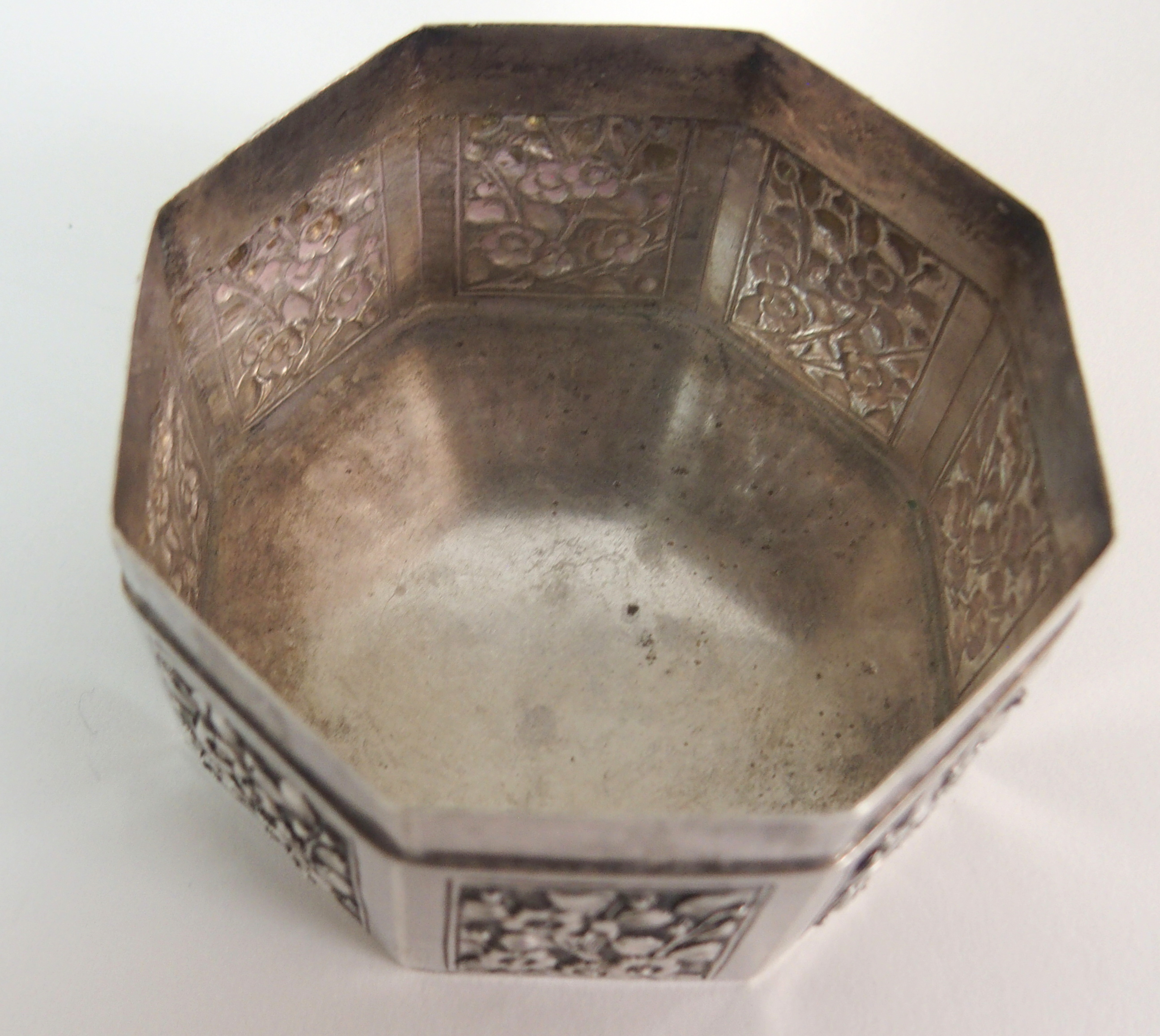 Lot 66 - A SET OF THREE CHINESE SILVER OCTAGONAL BOXES each surrounding the other and decorated with birds