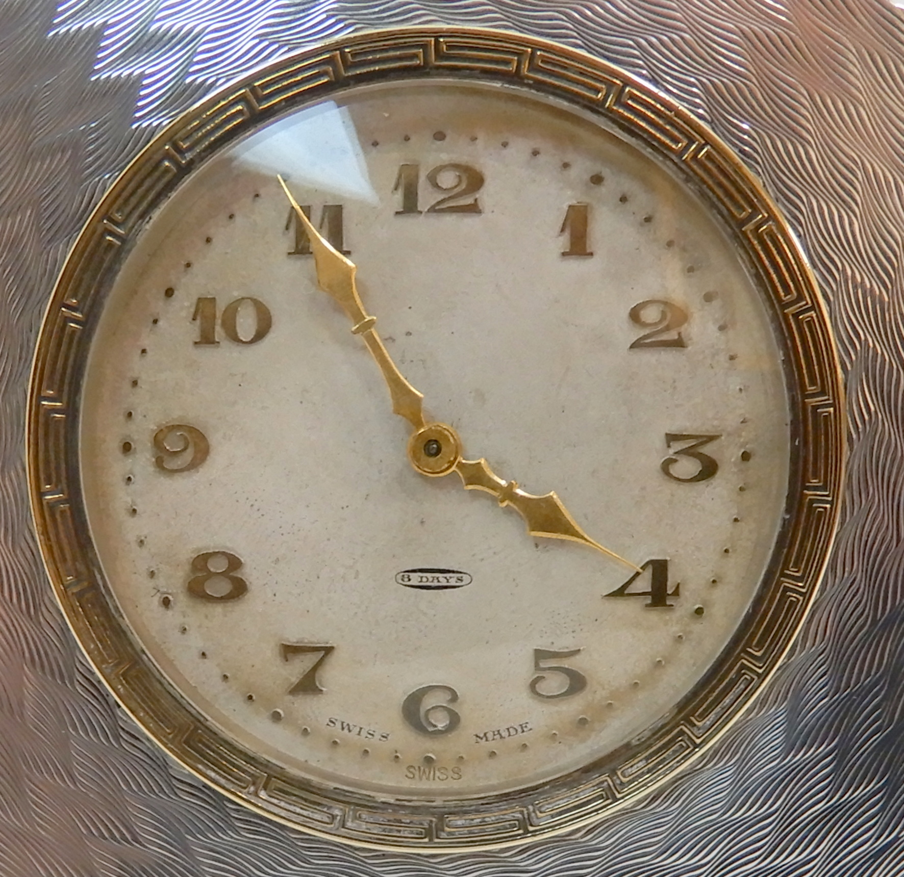 Lot 149 - A BOUDOIR CLOCK WITH SWISS 8-DAY MOVEMENT in engine turned decorated sterling silver case modelled